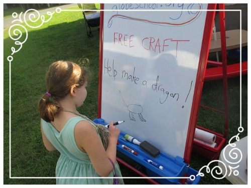 Collaborative dragon-making at a juried art show in Saratoga Springs, NY, August 2015 - Lise, at 11, follows a spontaneous spark of inspiration.