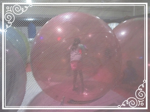Zorbing at her cousin's party - a bouncy, bumpy kind of variety.