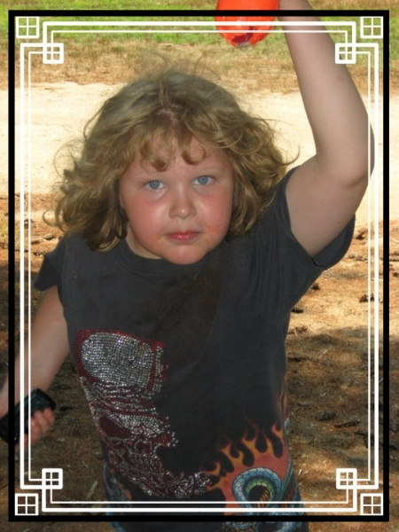Normally placid and easygoing, this boy has a warrior side, too! At Unschoolers Rock the Campground, age 8.